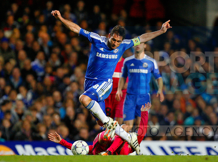 Frank Lampard of Chelsea is tackled by Jelle Vossen of KRC Genk during the Champions League match between Chelsea and KRC Genk at Stamford Bridge, London, England, on October 19, 2011. Photo Credit SPORTIMAGE/JAKE BADGER
