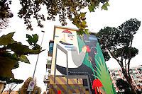 Titolo: The blind wall,  Artista Agostino Iacurci<br /> Title The blind wall, Artist Agostino Iacurci<br /> L'artista spalanca un mondo parallelo, in un ambiente domestico qualunque. La facciata di una casa popolare diventa trasparente,  e ci rivela un uomo, intento ad innaffiare un giardino immaginario.<br /> The painting shows the interior of a house, whit a man, watering his imaginary garden<br /> Roma 17-11-2015 Street Art a Roma. In vari quartieri di Roma e' fiorita la Street Art, con splendidi murales che hanno lo scopo di raccontare delle storie della citta', di commemorare dei momenti importanti, o semplicemente di interpretarla.<br /> Street Art in Rome. Very important writers  painted Murales in various districts of Rome to tell stories about the city, to commemorate important moments, to embellish the quarter or simply to portray it.  <br /> Photo Samantha Zucchi Insidefoto