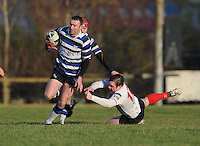 4th January 2014; Bryan Dixon, Corinthians, evades the tackle of Michael Barker, Malone. Ulsterbank League Division 1B, Corinthians RFC v Malone RFC, Corinthian Park, Galway. Picture credit: Tommy Grealy/actionshots.ie.
