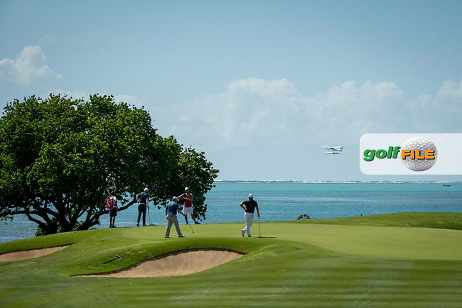 players on the green during the 1st round of the AfrAsia Bank Mauritius Open, Four Seasons Golf Club Mauritius at Anahita, Beau Champ, Mauritius. 29/11/2018<br /> Picture: Golffile | Mark Sampson<br /> <br /> <br /> All photo usage must carry mandatory copyright credit (© Golffile | Mark Sampson)