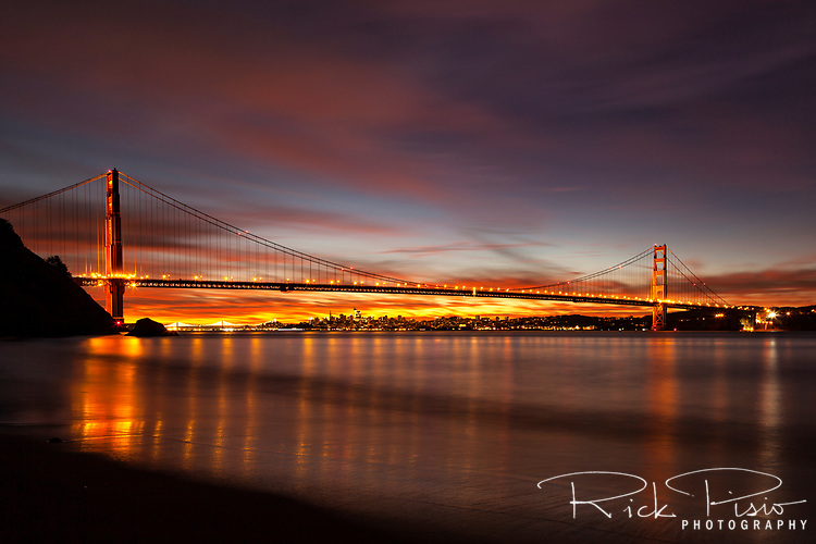 Golden Gate Bridge and San Francisco at dawn viewed from Kirby Cove.