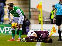 3rd March 2020; Easter Road, Edinburgh, Scotland; Scottish Premiership Football, Hibernian versus Heart of Midlothian; Sean Clare of Hearts lies injured on the touchline