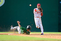 Shortstop Javier Guerra (31) of the Greenville Drive turns a double play, putting out Jonathan Johnson of the Savannah Sand Gnats in a game on Sunday, July 5, 2015, at Fluor Field at the West End in Greenville, South Carolina. Savannah won, 8-6. (Tom Priddy/Four Seam Images)