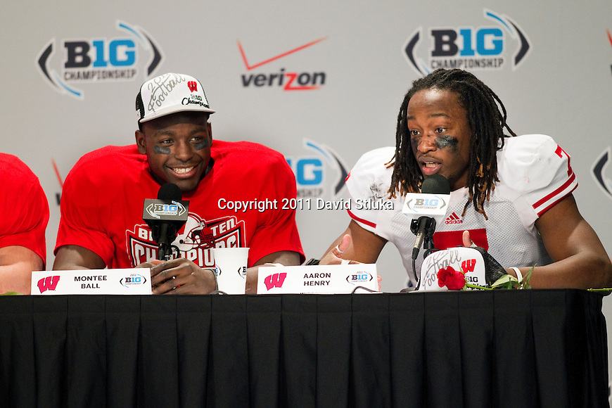 Wisconsin Badgers defensive back Aaron Henry (7) talks to reporters as running back Montee Ball (28) looks on after the NCAA Big Ten Conference Championship college football game against the Michigan State Spartans on December 3 , 2011 in Indianapolis, Indiana. The Badgers won 42-39. (Photo by David Stluka)
