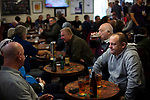 Supporters in the social club at the UTS Stadium before the FA Cup fourth qualifying round match between Dunston UTS and their local rivals Gateshead. Founded in 1975, the home team were formerly known as Dunston Federation. The visitors won 4-0 watched by a record crowd of 2,500.