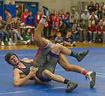 Spanish Springs Cougars Dustin Congdon, top, wrestles Reno Huskies Matthew Barnard in the 132 pound weight class on Wednesday night, January 13, 2016 at Reno High School.