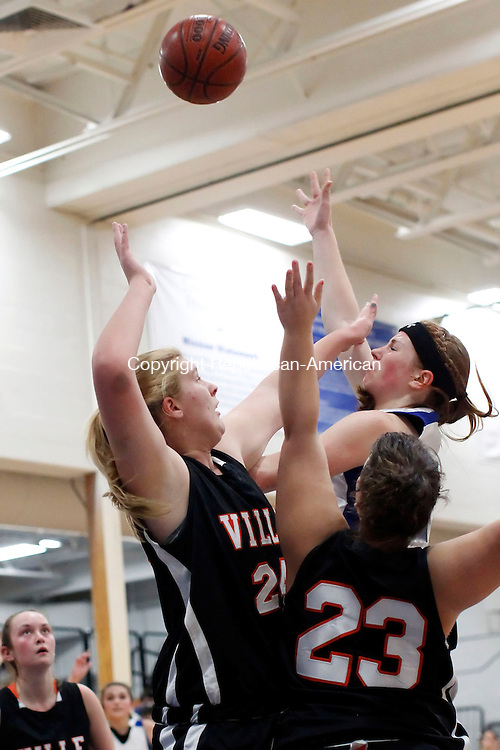 Burlington, CT-11 December 2012-121112CM13- Lewis Mills' Teagan Dunn puts up a hookshot over Terrvyille's Liz Klopp, left, and Morgan Downey Tuesday night in Burlington.  Dunn was fouled on the play and made her foul shot making it a three point play.  Mills won 59-35.  Christopher Massa Republican-American