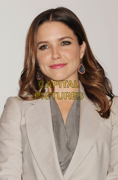 Sophia Bush.The People's Choice Awards 2013 Nomination Announcements at The Paley Center for Media in Beverly Hills, California, USA. .November 15th, 2012.headshot portrait grey gray jacket suit beige blazer top gold blue dangling earrings .CAP/ROT/TM.©Tony Michaels/Roth Stock/Capital Pictures