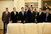 United States President Barack Obama meets with crew members of the Space Shuttle Endeavour in the Oval Office at the White House in Washington, D.C., U.S., on Thursday, April 22, 2010. The crew is Commander George Zamka, Pilot Terry Virts, Mission Specialists Robert Behnken, Mission Specialist Stephen Robinson, Mission Specialist Nicholas Patrick, and Mission Specialist Kathryn Hire, from left. .Credit: Brendan Hoffman - Pool via CNP