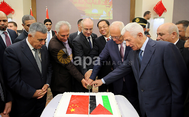 Palestinian Prime Minister Rami Hamdallah attends the Chinese National Day ceremony, in the West Bank city of Ramallah, on Sep. 26, 2016. Photo by Prime Minister Office