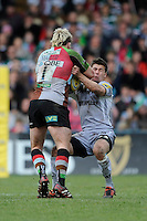 Ben Youngs of Leicester Tigers (right) is knocked down by Joe Marler of Harlequins during the Aviva Premiership match between Harlequins and Leicester Tigers at The Twickenham Stoop on Saturday 21st April 2012 (Photo by Rob Munro)