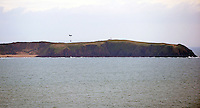 Pictured: A Chinook helicopter carries a fire engine to Caldey Island off the Pembrokeshire coast, Wales, UK. Tuesday 24 January 2017<br /> Re: A Fire and Rescue Appliance has been delivered to Caldey Island via Chinook Helicopter. <br /> Mid and West Wales Fire and Rescue Service and the RAF have flown a Rural Response Pump to Caldey Island.<br /> The island, off Tenby in Pembrokeshire is inhabited by Cistercian Monks
