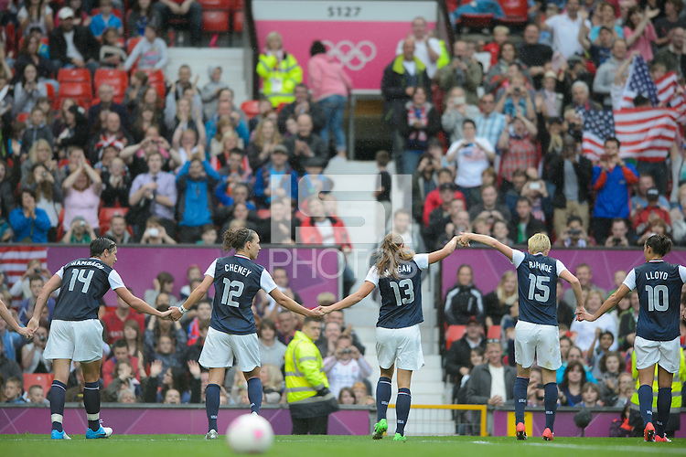Manchester, England - July 31, 2012: The USA Women's soccer team 1-0 over North Korea during the opening round of the Olympic football tournament at Old Trafford. The USA celebrates Abby Wambach's goal.