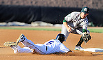 SIOUX FALLS, SD - JULY 18:  Cory Morales #5 from the Sioux Falls Canaries is tagged out at second by Zac Mitchell #7 from the Gary South Shore Rail Cats in the first inning of their gameThursday evening at the Sioux Falls Stadium.(Photo by Dave Eggen/Inertia)