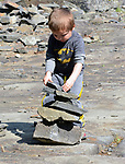 Young visitor inspired to attempt his own creation at the Opus 40 Sculpture Park on Fite Road, in Saugerties, NY on Sunday May 21, 2017. Photos by jim Peppler. Copyright Jim Peppler/2017.