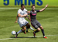 Leeds United's Patrick Bamford (right) under pressure from Swansea City's Ben Cabango<br /> <br /> Photographer Andrew Kearns/CameraSport<br /> <br /> The EFL Sky Bet Championship - Swansea City v Leeds United - Sunday 12th July 2020 - Liberty Stadium - Swansea<br /> <br /> World Copyright © 2020 CameraSport. All rights reserved. 43 Linden Ave. Countesthorpe. Leicester. England. LE8 5PG - Tel: +44 (0) 116 277 4147 - admin@camerasport.com - www.camerasport.com
