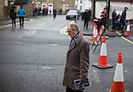 A home fan making hid way towards the stadium before Burnley hosted Everton in an English Premier League fixture at Turf Moor. Founded in 1882, Burnley played their first match at the ground on 17 February 1883 and it has been their home ever since. The visitors won the match 5-1, watched by a crowd of 21,484.