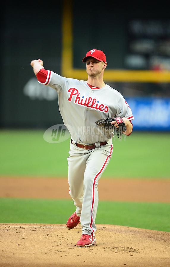 Apr. 23, 2012; Phoenix, AZ, USA; Philadelphia Phillies pitcher Kyle Kendrick throws in the first inning against the Arizona Diamondbacks at Chase Field. Mandatory Credit: Mark J. Rebilas-