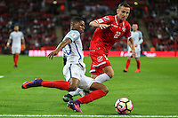 Marcus Rashford (Manchester United) of England crosses under pressure from Alex Muscat of Malta during the FIFA World Cup qualifying match between England and Malta at Wembley Stadium, London, England on 8 October 2016. Photo by David Horn / PRiME Media Images.