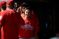 Philadelphia Phillies Rafael Marchan (6) high fives teammates in the dugout after hitting a home run during a Florida Instructional League game against the Baltimore Orioles on October 4, 2018 at Ed Smith Stadium in Sarasota, Florida.  (Mike Janes/Four Seam Images)