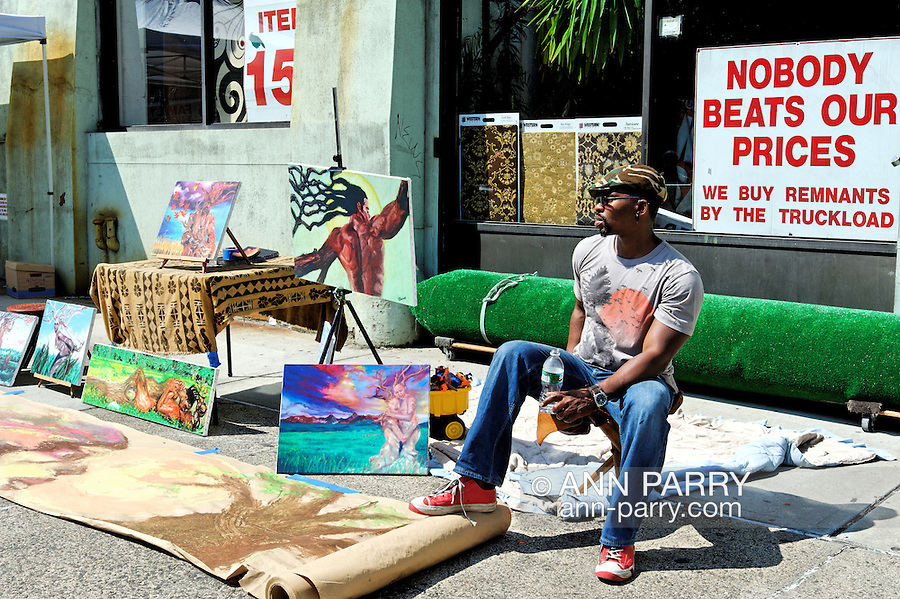 Brooklyn, New York, June 6, 2009.  Artist selling his paintings and drawings outdoors during Atlantic Avenue ArtWalk.