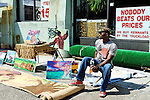 Brooklyn, New York, June 6, 2009.  Artist selling his paintings and drawings outdoors during Atlantic Avenue ArtWalk.