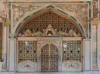 View from the front of the Gate of the Imperial Council Chamber, (Divan-i Humayun), Topkapi Palace, 1459, Istanbul, Turkey. The present Council Chamber dates from the reign (1520-66) of Suleyman the Magnificent and was restored in 1665 after a fire. These rococo style gates have gilded grills to admit natural light. The Topkapi Palace, commissioned by Sultan Mehmed II, was the main residence of the Ottoman Sultans in Istanbul. The historical areas of the city were declared a UNESCO World Heritage Site in 1985. Picture by Manuel Cohen.