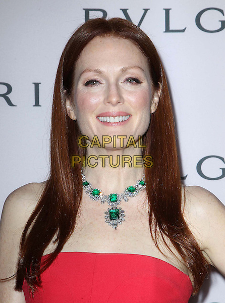 Julianne Moore.BVLGARI celebrates Elizabeth Taylor's magnificent collection of BVLGARI jewelry held at the BVLGARI store, Beverly Hills, California, USA..February 19th, 2013.headshot portrait red strapless diamond green emerald necklace jewellery jewelry .CAP/ADM/FS.©Faye Sadou/AdMedia/Capital Pictures.