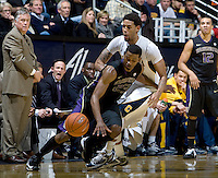 C.J. Wilcox of Washington controls the ball away from Allen Crabbe of California during the game at Haas Pavilion in Berkeley, California on January 9th, 2013.   Washington defeated California, 62-47.