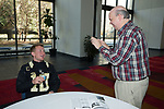 Wake Forest Demon Deacons quarterback John Wolford (10) shares a laugh with Les Johns of Demon Deacon Digest during Media Day for the 2017 Belk Bowl at the Charlotte Convention Center on December 28, 2017 in Charlotte, North Carolina.  (Brian Westerholt/Sports On Film)