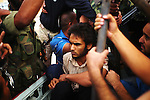 Sirte, LIBYA: Monday 11th October 2011:..A suspected Gaddafi loyalist soldier is taken prisoner by rebel fighters. ..Ayman Oghanna