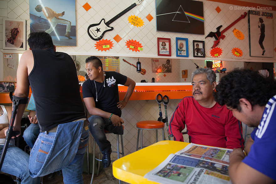 "Players from Guerreros Aztecas meet for lunch at a burger's restaurant in Mexico City, Mexico on July 27 2014. Guerreros Aztecas (""Aztec Warriors"") is Mexico City's first amputee football team. Founded in July 2013 by five volunteers, they now have 23 players, seven of them have made the national team's shortlist to represent Mexico at this year's Amputee Soccer World Cup in Sinaloa this December. The team trains twice a week for weekend games with other teams. No prostheses are used, so field players missing a lower extremity can only play using crutches. Those missing an upper extremity play as goalkeepers. The teams play six per side with unlimited substitutions. Each half lasts 25 minutes. The causes of the amputations range from accidents to medical interventions – none of which have stopped the Guerreros Aztecas from continuing to play. The players' age, backgrounds and professions cover the full sweep of Mexican society, and they are united by the will to keep their heads held high in a country where discrimination against the disabled remains widespread. (Photo by Bénédicte Desrus)"