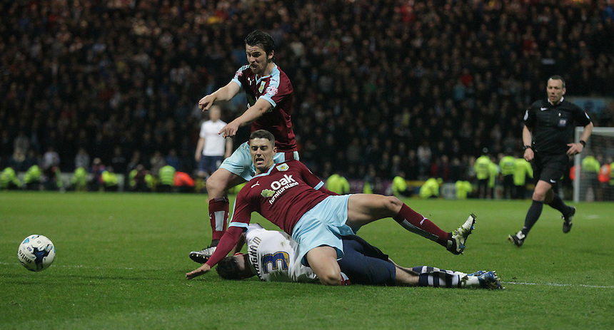 Preston North End's Greg Cunningham appears to be fouled by Burnley's Matthew Lowton and Joey Barton in the penalty area but Referee Kevin Friend gave the free kick outside the area<br /> <br /> Photographer Stephen White/CameraSport<br /> <br /> Football - The Football League Sky Bet Championship - Preston North End v Burnley - Friday 22nd April 2016 - Deepdale - Preston <br /> <br /> &copy; CameraSport - 43 Linden Ave. Countesthorpe. Leicester. England. LE8 5PG - Tel: +44 (0) 116 277 4147 - admin@camerasport.com - www.camerasport.com