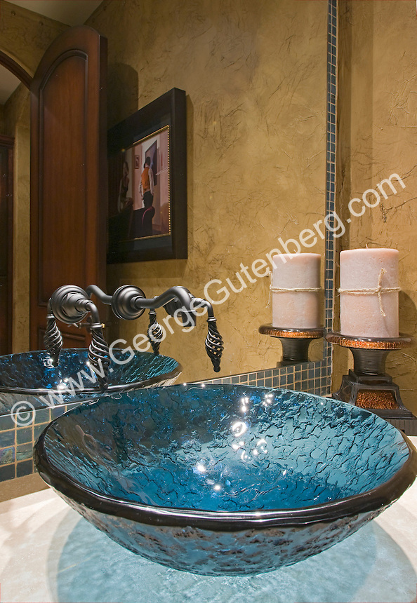 Blue Glas Sink in Powder room Stock photo of residential guest bathroom, powder room.