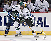 John Hopson, Drew Miller - The University of Maine Black Bears defeated the Michigan State University Spartans 5-4 on Sunday, March 26, 2006, in the NCAA East Regional Final at the Pepsi Arena in Albany, New York.