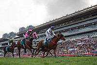 SHA TIN,HONG KONG-MAY 07: Contentment #3,ridden by Brett Prebble (blue cap), wins the Champions Mile at Sha Tin Racecourse on May 7,2017 in Sha Tin,New Territories,Hong Kong (Photo by Kaz Ishida/Eclipse Sportswire/Getty Images)