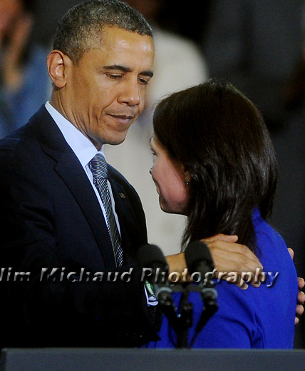 President Obama comforts an emotional Nicole Hockley, who introduced the President, her son Dylan was one of the twenty students killed at the Sandy Hook Elementary School last December, Monday, April 8, 2013, at the University of Hartford. Obama spoke at times with raised voice as he demanded congress to pass gun control legislation, several times calling for action while pointing to the families of the Newtown mass shooting, many of whom were sitting in the front row.  (Jim Michaud / Journal Inquirer).
