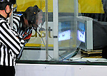 22 November 2011: NCAA Hockey East Referee Scott Whittemore reviews a play in the third period between the University of Vermont Catamounts and the University of Massachusetts Minutemen at Gutterson Fieldhouse in Burlington, Vermont. After review, a goal was disallowed as University of Vermont Catamount forward H.T. Lenz was in the crease during the play. The Catamounts defeated the Minutemen 2-1 in their annual pre-Thanksgiving meeting of the Hockey East season. Mandatory Credit: Ed Wolfstein Photo