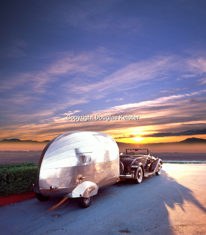 1935 Bowlus Papoose, pulled by a '34 Packard Coupe Roadster, into the sunset