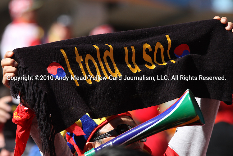 "17 JUN 2010: A South Korea fan holds up a scarf reading ""I told u sol"". The Argentina National Team defeated the South Korea National Team 4-1 at Soccer City Stadium in Johannesburg, South Africa in a 2010 FIFA World Cup Group E match."