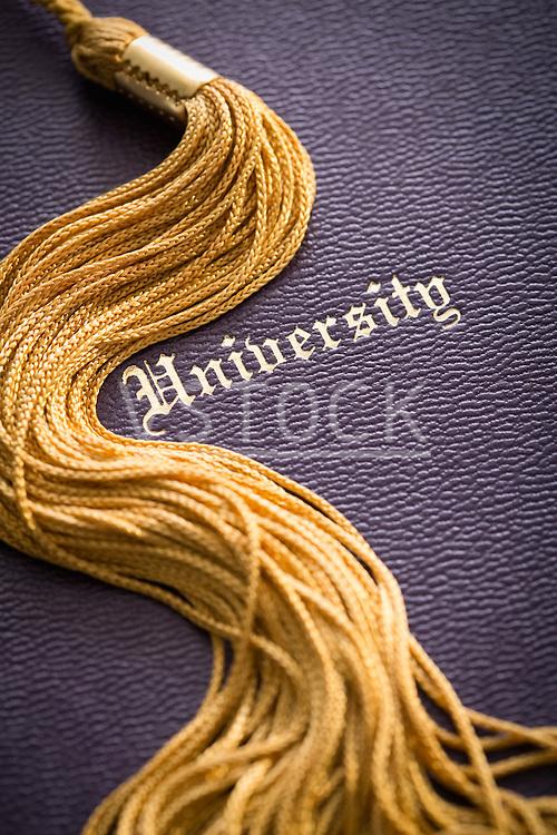 Close-up view of graduation tassel and diploma