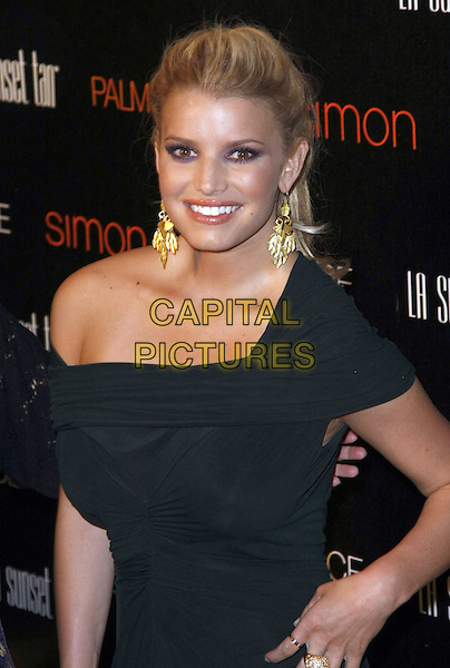 JESSICA SIMPSON.Palms Place Hotel and Spa Grand Opening, Las Vegas, Nevada, USA, .31 May 2008..half length gold earrings black dress  ponytail off one the shoulder.CAP/ADM/MJT.©MJT/Admedia/Capital Pictures