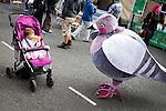 © Joel Goodman - 07973 332324 . 31 August 2013 . Rochdale , UK . Shakeela Mahon (11 months old, from Newbold in Rochdale, correct) meets a friendly pigeon . The Rochdale Feel Good Festival . Photo credit : Joel Goodman