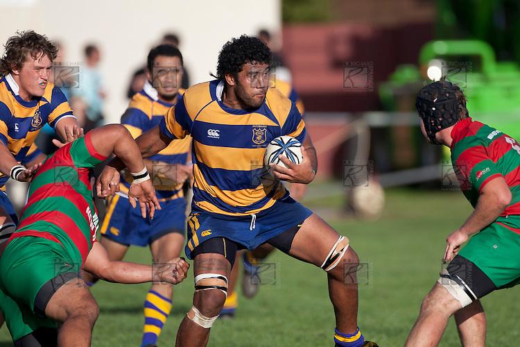 Alepini Olosoni brushes off the tackle of Maka Tatafu.  Counties Manukau Premier Club Rugby game between Waiuku and Patumahoe, played at Waiuku on Saturday April 23rd 2011. Patumahoe won 21 - 20 after leading 6 - 0 at halftime.
