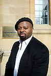 Ben Okri, Booker Prize winning author, in front of the Oxford Martin School, during the FT Weekend Oxford Literary Festival, Oxford, UK. Saturday 29 March 2014.<br /> <br /> PHOTO COPYRIGHT Graham Harrison<br /> graham@grahamharrison.com<br /> <br /> Moral rights asserted.