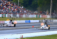 May 31, 2014; Englishtown, NJ, USA; NHRA top fuel driver Morgan Lucas (right) races alongside Antron Brown during qualifying for the Summernationals at Raceway Park. Mandatory Credit: Mark J. Rebilas-
