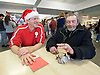 Crisis at Christmas, London, Great Britain <br /> 23rd December 2016 <br /> <br /> First day of operations at one of the Crisis centres in London with a homeless man called John who is often found around the Trafalgar Square area originally from Dover in Kent  talks to a volunteer called JJ from Cricklewood in London. <br /> <br /> Crisis at Christmas is a lifeline for thousands of homeless people across the UK, offering support, companionship and vital services over the festive period.<br />  <br /> Crisis at Christmas provides immediate help for homeless people at a critical time - one in four homeless people spends Christmas alone - but our work does not end there. We encourage guests to take up the life-changing opportunities on offer all year round at our centres across the country. <br />  <br /> Crisis is the national charity for homeless people.<br /> <br /> Crisis reveals scale of violence and abuse against rough sleepers as charity opens its doors for Christmas<br /> <br /> People sleeping on the street are almost 17 times more likely to have been victims of violence and 15 times more likely to have suffered verbal abuse in the past year compared to the general public, according to new research from Crisis, the national charity for homeless people.<br />  <br /> <br /> Photograph by Elliott Franks <br /> Image licensed to Elliott Franks Photography Services