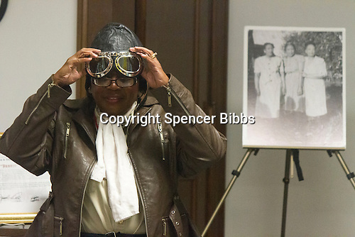 Gigi Coleman, the niece of Bessie Coleman dressed as Bessie Coleman, describes how her aunt became a world-famous aviator despite the problems of poverty and race that could have held her back Tuesday afternoon at the Blackstone Library located at 4904 S. Lake Park Avenue.<br /> <br /> Please 'Like' &quot;Spencer Bibbs Photography&quot; on Facebook.<br /> <br /> All rights to this photo are owned by Spencer Bibbs of Spencer Bibbs Photography and may only be used in any way shape or form, whole or in part with written permission by the owner of the photo, Spencer Bibbs.<br /> <br /> For all of your photography needs, please contact Spencer Bibbs at 773-895-4744. I can also be reached in the following ways:<br /> <br /> Website &ndash; www.spbdigitalconcepts.photoshelter.com<br /> <br /> Text - Text &ldquo;Spencer Bibbs&rdquo; to 72727<br /> <br /> Email &ndash; spencerbibbsphotography@yahoo.com