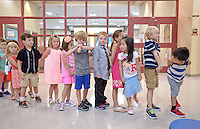 NWA Democrat-Gazette/BEN GOFF &bull; @NWABENGOFF<br /> Kindergarteners in Natalie Marts' class line up while learning how to go through the lunch line on Monday Aug. 3, 2015 during the first day of school at R.E. Baker Elementary in Bentonville. Baker and Elm Tree elementary schools in Bentonville run on a nontraditional calendar.