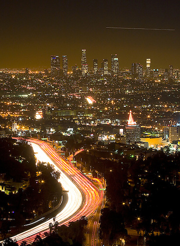 THE HOLLYWOOD FREEWAY WINDS ITS WAY THROUGH THE CITY OF LOS ANGELES DURING EARLY EVENING RUSH HOUR